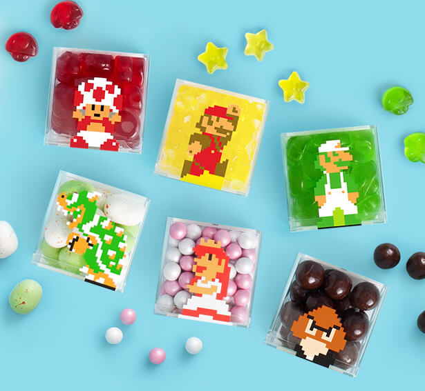 Sugarfina and Super Mario Brothers Candy Cubes including Toad, Mario, Luigi, Bowser, Peach and Goomba